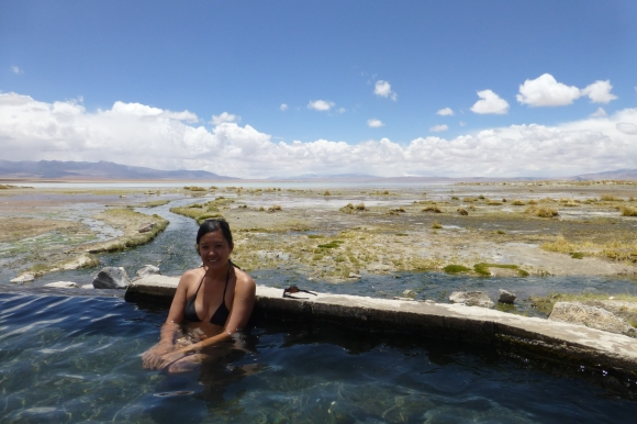 Soaking in the hot springs, with a lake in the backdrop
