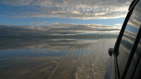 Driving through the Salar's waters