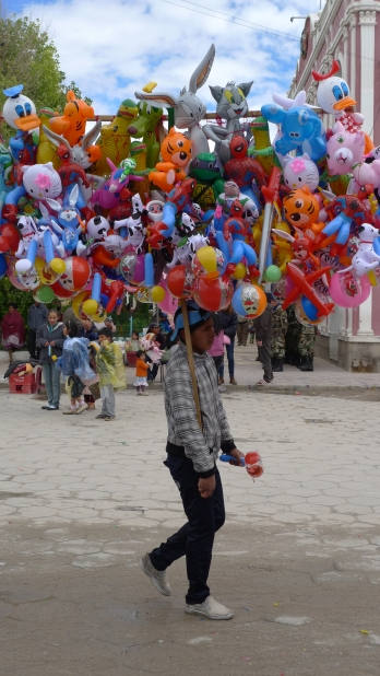 Balloon and water pistol vendors