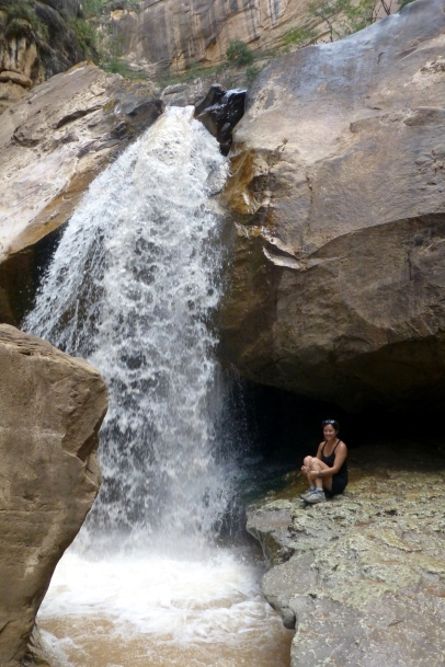 Taking a refreshing hower by a waterfall